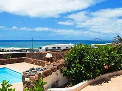 Bungalow accommodation with pool at Famara beach, Lanzarote