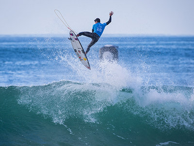 Image: WSL / Damien Poullenot | Caption: Gabriel Medina (BRA) takes to the air.